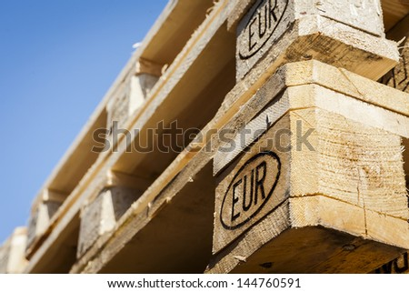 Wooden transport pallets in stacks.  - stock photo