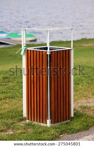 Wooden trash bin in the park - stock photo