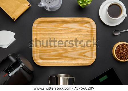 Wooden Tray Surrounded By Coffee Making Equipment On Gray Backgr