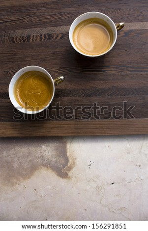 wooden tray with cups of coffee - stock photo