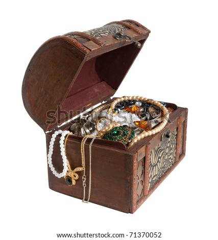 Wooden treasure chest with valuables, isolated with  clipping path - stock photo
