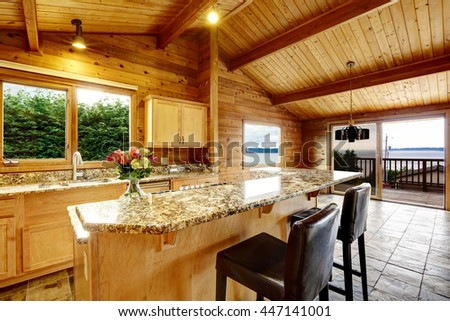 Wooden trim home with open floor plan. Kitchen with granite counter top. Water view