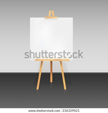 Wooden tripod with a white sheet of paper standing in the room - stock photo