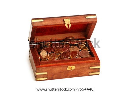 Wooden trunk full of golden coins isolated on white - stock photo