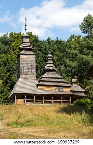Wooden ukrainian antique orthodox church in summer in Pirogovo museum, Kiev, Ukraine - stock photo
