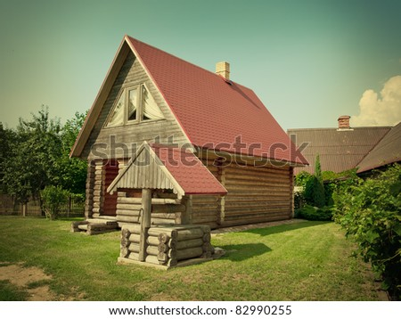 wooden village house and well in the yard