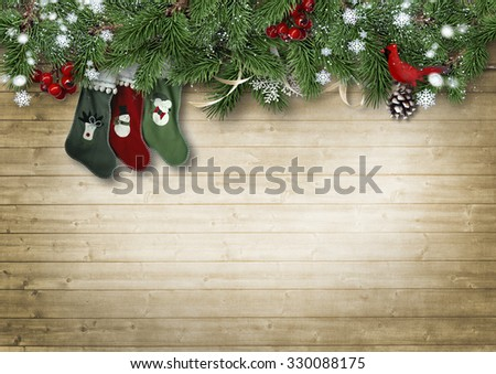 Wooden vintage background with fir branches and Christmas Sock. Christmas background with space for photo or text - stock photo