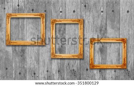Wooden vintage frame on wooden background - stock photo