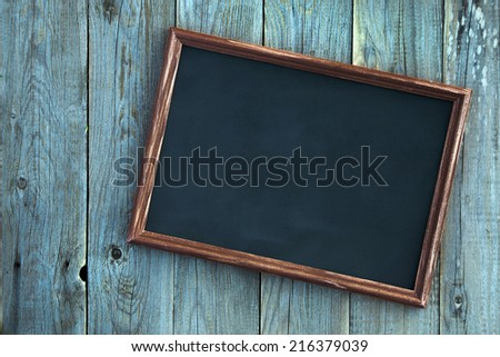 wooden vintage frame over old blue wooden background and place for text - stock photo