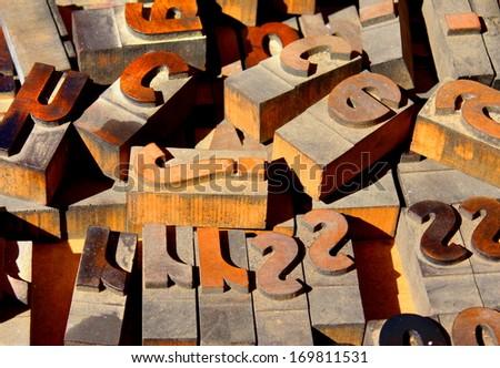 wooden vintage letterpress printing blocks - stock photo