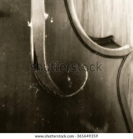 Wooden violin part on black background, macro. - stock photo