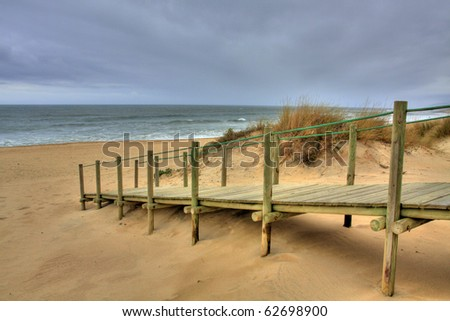 Wooden walk way over sand dune giving access to the beach, Esposende, Portugal (HDR photo) - stock photo