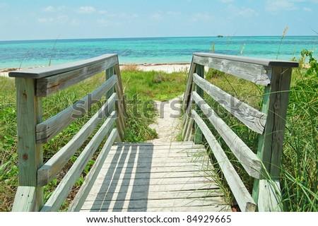 wooden walkway leading to Bahia Honda beach in the Florida Keys - stock photo