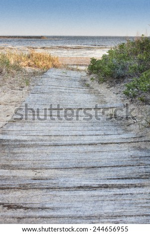 Wooden walkway leading to beach on Cape Cod, Wellfleet Massachusetts - stock photo