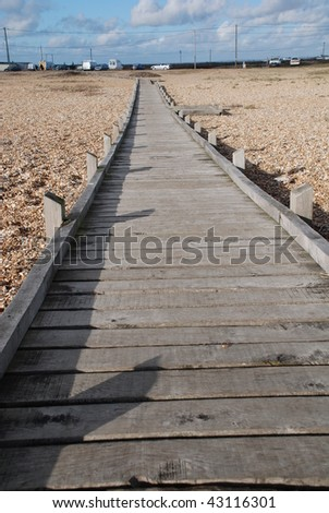 Wooden walkway on Dungeness beach in Kent, England.