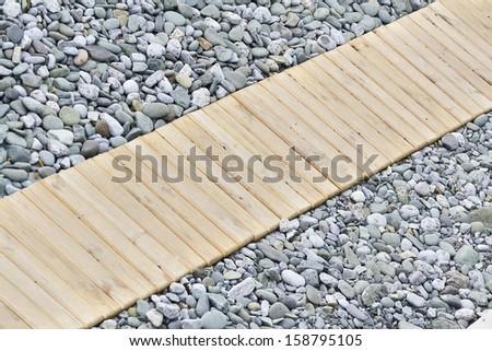 wooden walkway on the beach - stock photo