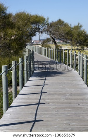 Wooden walkway over the sand dunes to the beach