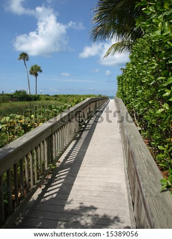 Wooden Walkway to Beach perspective blue sky - stock photo