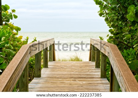 Wooden walkway to the ocean - stock photo