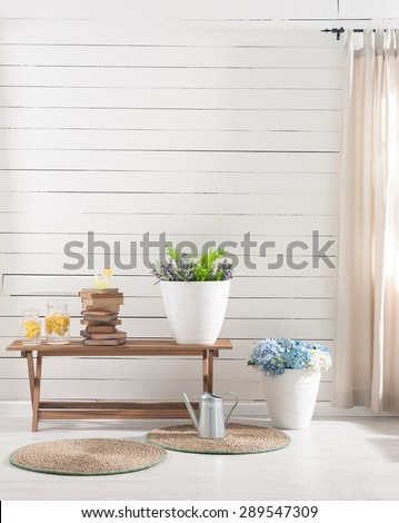 wooden wall desk and flowers - stock photo