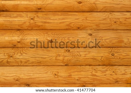 Wooden wall from logs in decline beams - stock photo