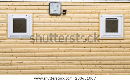 Wooden wall on a new log cabin - stock photo