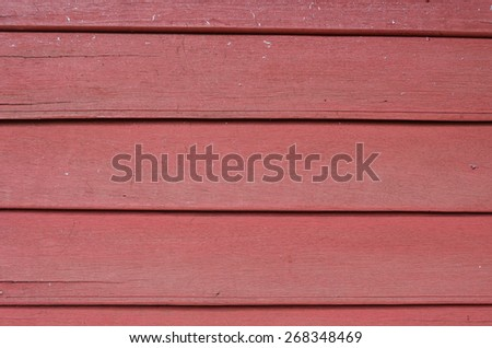 Wooden wall. red background - stock photo