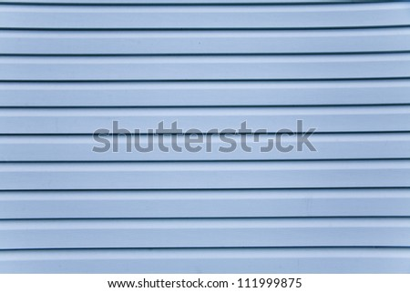 Wooden wall. Slice the blue siding - stock photo