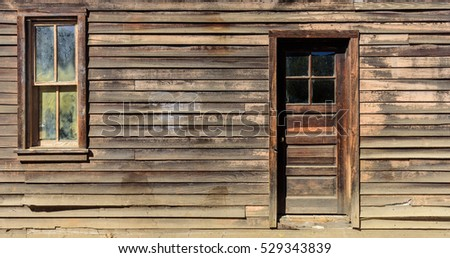 Wooden wall with door and window