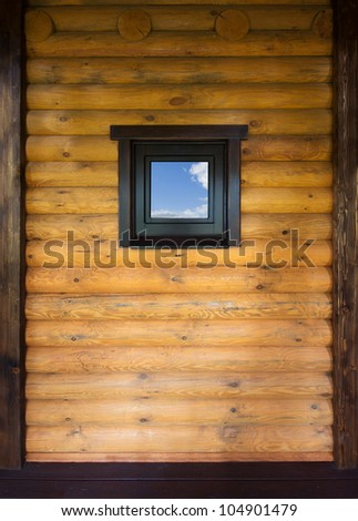 Wooden wall with small window - stock photo