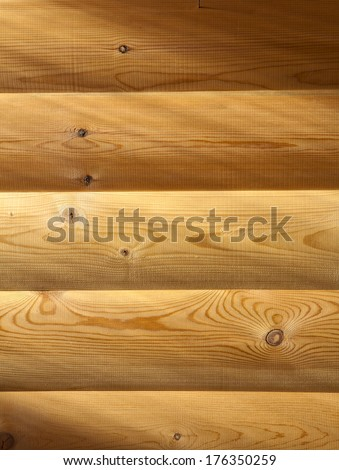 wooden wall with sun light shadows - stock photo
