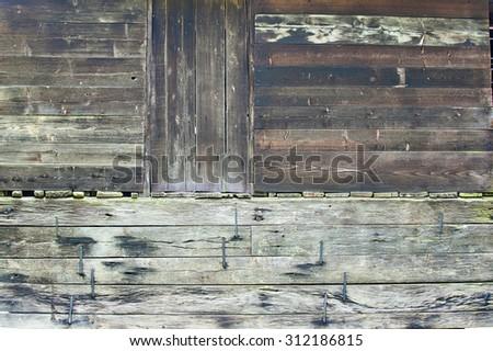 Wooden wall with wooden door - stock photo