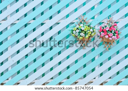 Wooden walls are white with a green switch. Hanging flowers. - stock photo