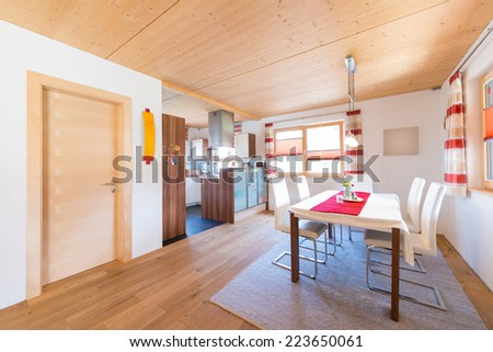 wooden warm mud of kitchen and dining room in timber house - stock photo