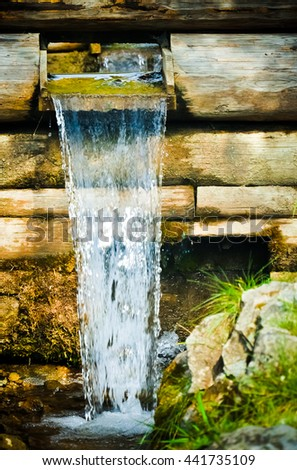Wooden water channel close up - stock photo