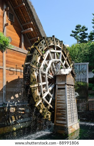 Wooden water wheel mill - stock photo