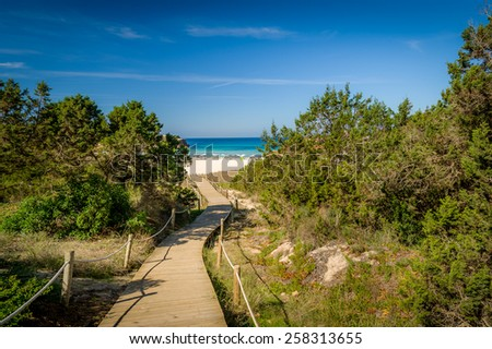 Wooden way to Mediterranean sand beach. Balearic islands, Spain - stock photo