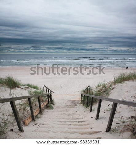 Wooden way to the beach on baltic sea - stock photo