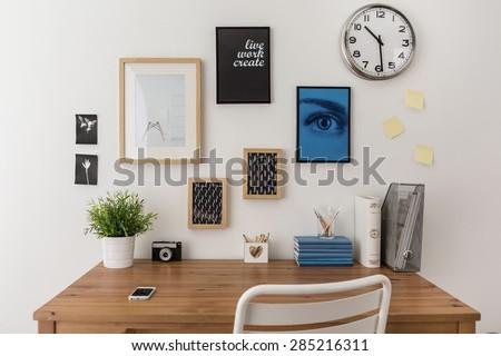 Wooden well arranged desk prepared to work - stock photo