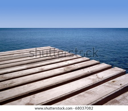 Wooden wharf and blue sea - stock photo