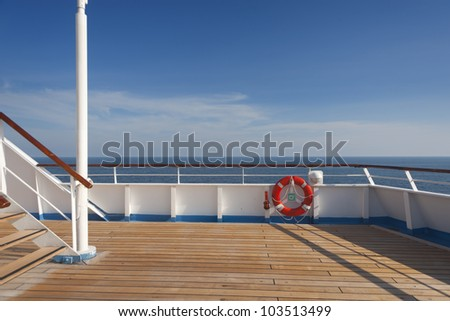 Wooden wharf,buoy and blue Sky - stock photo