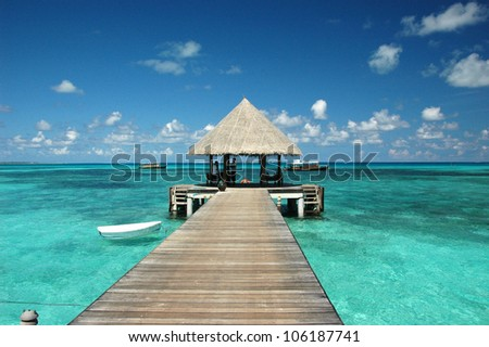 Wooden wharf with pavilion for ships at Maldives - stock photo