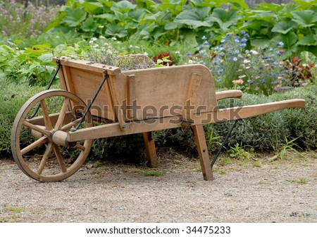 wooden wheelbarrow in a garden