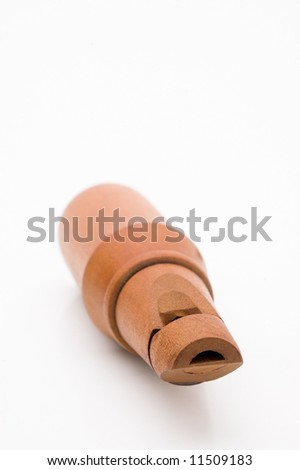 Wooden whistle.