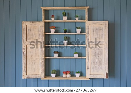 Wooden window closet with many fake flowers' decoration - stock photo
