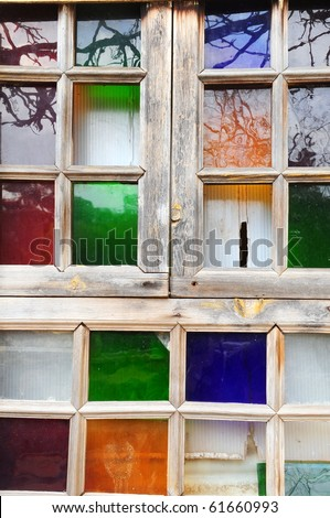 wooden window (door)Multicolored stained glass 