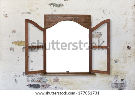 wooden window frame on pastel toned old grungy wall - stock photo
