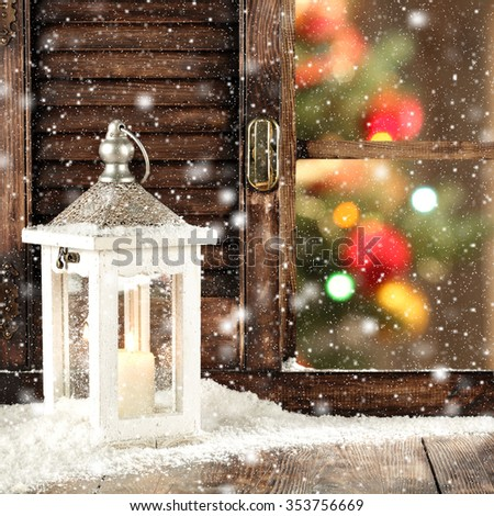wooden window sill of snow lamp and xmas tree  - stock photo