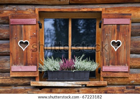Wooden window with heart symbols - stock photo