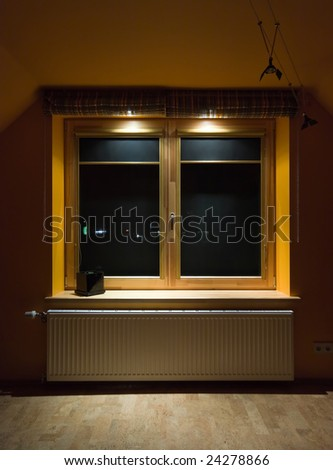 Wooden windows with separate lighting - stock photo